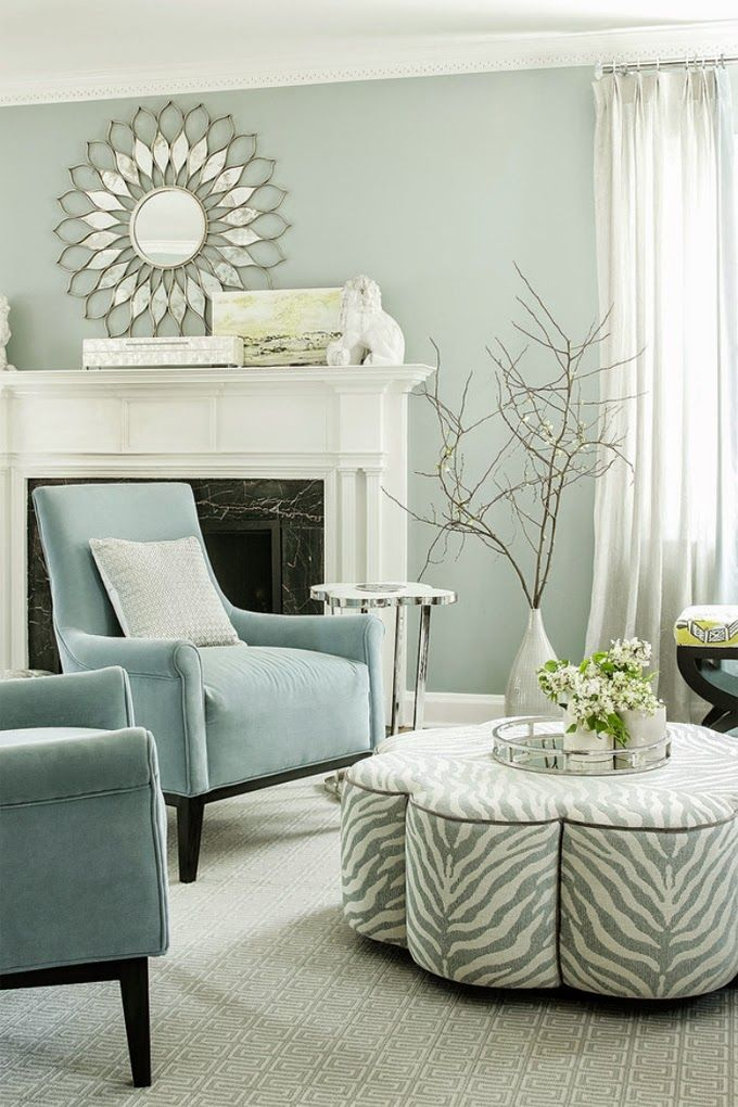 Love the Nantucket Fog paint color (Benjamin Moore) in this light and airy  living room. Beautiful white fireplace, too!