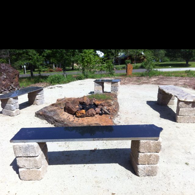 Garden benches made from granite remnants and concrete blocks.