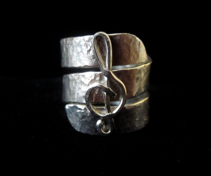 Music to my Ears.  A treble clef adorns this hammered sterling silver ring.