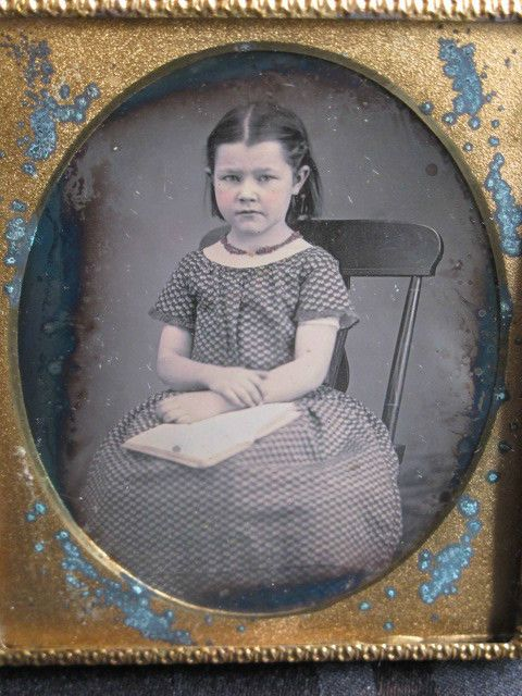 1/6 PLATE DAGUERREOTYPE OF A YOUNG GIRL-SEATED BOOK ON LAP-EARLY