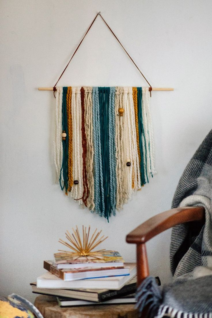 how to make an easy diy yarn wall hanging hgtv yarn on wall hanger id=63448