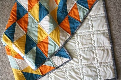 I like the quilting here....simple straight double lines on either side of seams