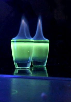 Exorcist: You'll need a black light to really make this one impressive.  Blue Curacao, Rockstar Energy Drink, Absithe. Mix Curacao and energy drink together, float absinthe on top, carefully light on fire.