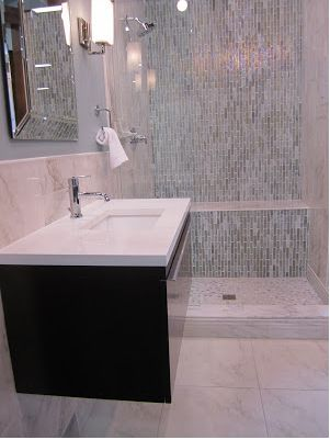 Wall hung vanity, glass and ceramic shower with bench