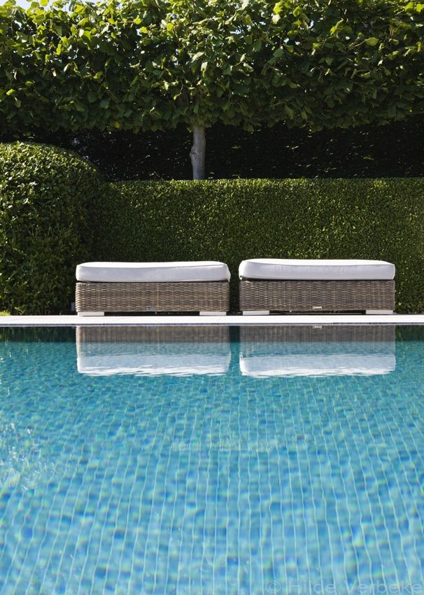 pale grey outdoor rattan | white limestone and clipped box hedge