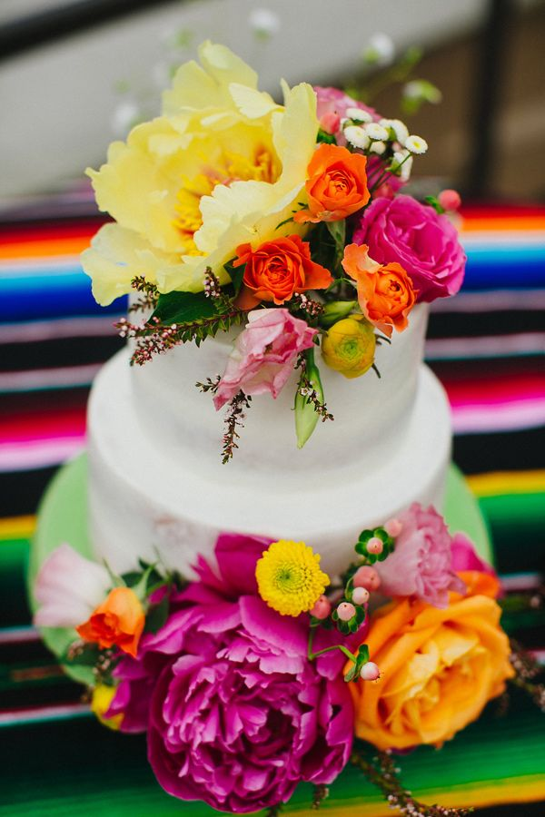wedding cake with bright flowers - photo by Amber Vickery http://ruffledblog.com/mid-century-mexican-wedding-at-the-belmont-dallas