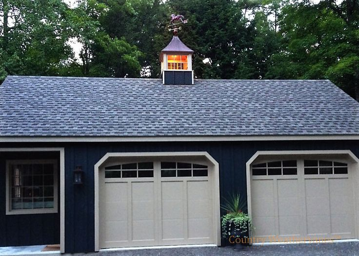 Exceptional Garage Cupola #1: Royal Crowne Carlisle Cupola With Running Horse Weathervane On Garage - The  Cupola Glows With Warmth