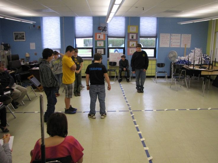 """""""Human"""" Sized Coordinate Graph Game - READ HOW TO PLAY HERE = http://www.mathfilefoldergames.com/human-sized-coordinate-graph-game/ Make a """"human"""" sized coordinate graph by placing tape on the floor for the x and y axis. Label the quadrants. Have a student stand at the origin, tell them the ordered pair. #mathgames #coolmath"""