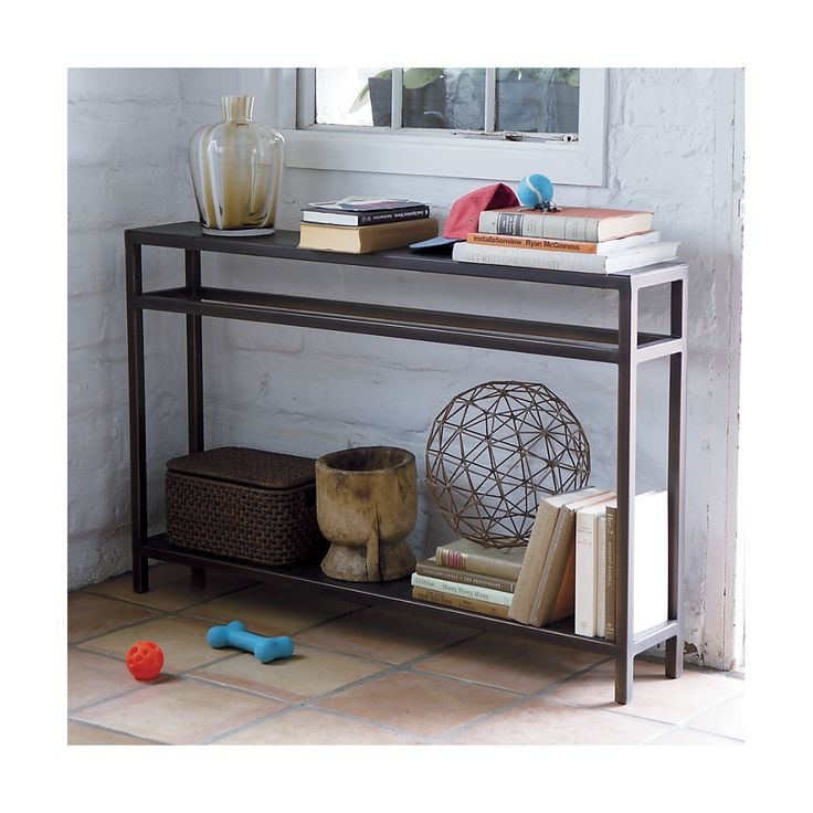 Shop Echelon Narrow Console Table.   The narrow console tables's top and low-lying shelf are each individually hand ground to create a fine, striated pattern, complemented by square iron legs that are honed and welded smooth.