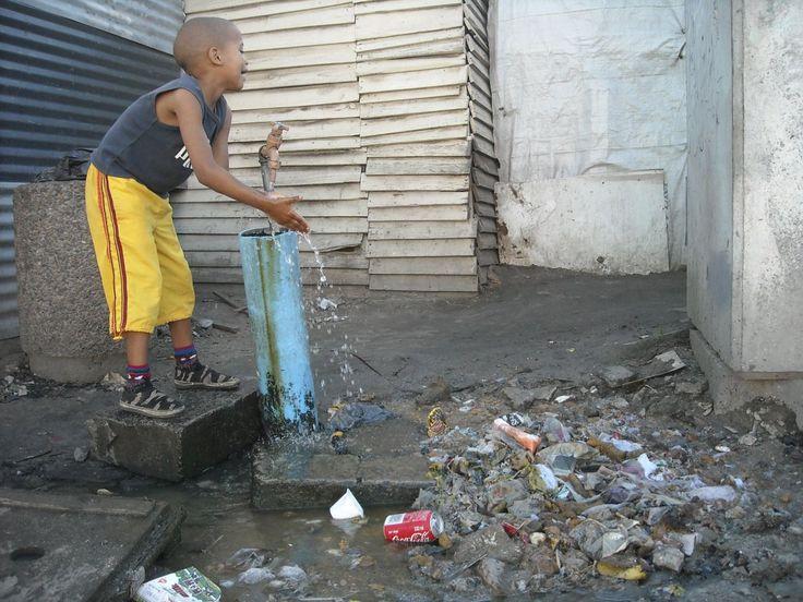 Sewage right next to communal water source