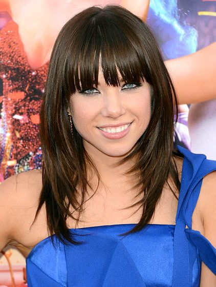 Carly Rae Jepsen knows how to rock bangs. We also love her face-framing layers!