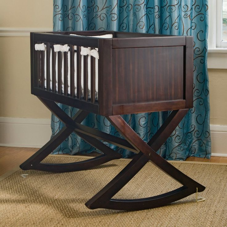 Elegant Brown Wooden Baby Cradle with Curved Style Cradle Legs abd Soft White Bedding Crib Decorating Inspirations for Furniture in the Baby Room