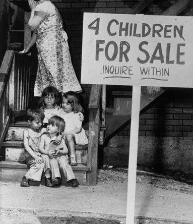 A penniless mother hides her face in shame after putting her children up for sale. Chicago, 1948.