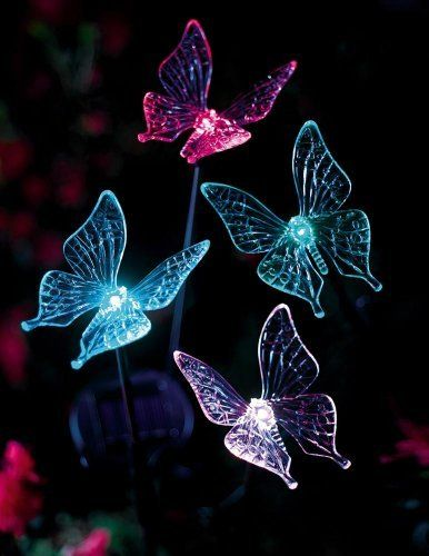 """Butterfly Solar Garden Stakes By Collections Etc by Natures Touch. $14.99. Measure 31 1/2""""H and 28"""" H x 2 3/4""""W. Create a colorful show with this set of 4 solar butterflies. Each glow in a display of ever changing red, blue, green & yellow light. Solar panel powers all 4 stake lights. 1 Rechargeable """"AA"""" solar battery is included. Create a colorful show with this set of 4 butterflies glowing in a display of ever changing red, blue, green & yellow light at night. ..."""