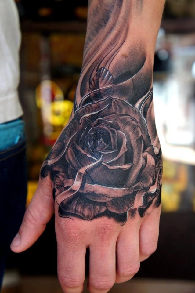 Rose tattoo. Hand placement.