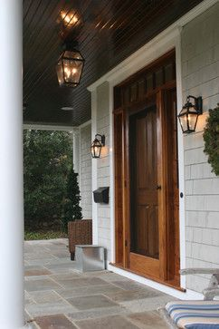 front solid door with a storm/screen door - also like the lanterns on either side and above as well as the windows going around the door