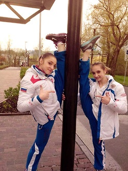 Aliya Mustafina and Viktoria Komova, Russian artistic gymnastics stars - love their friendship! (And their flexibility.)