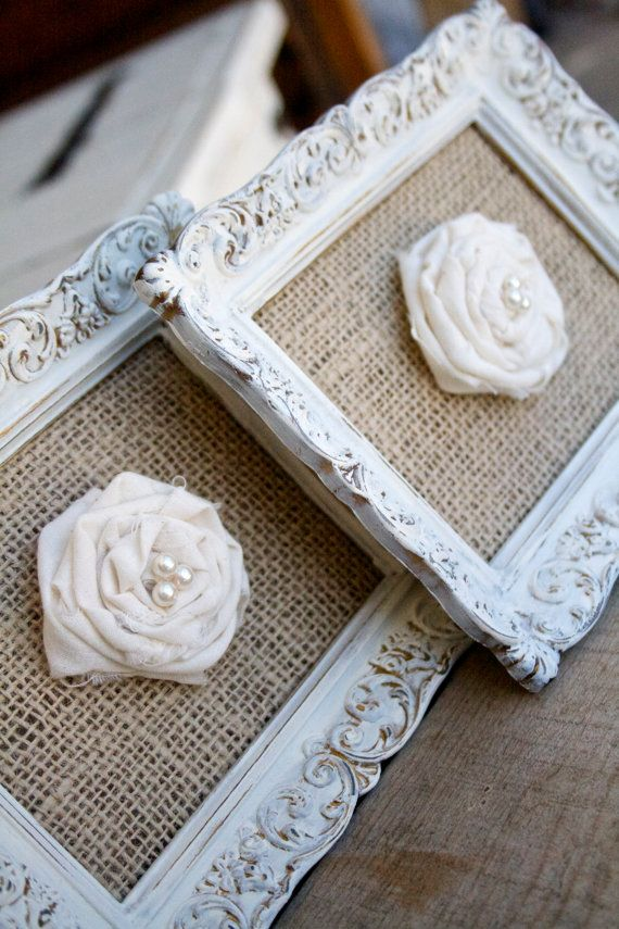 burlap in frames with tiny flower rosettes and pearl pins.