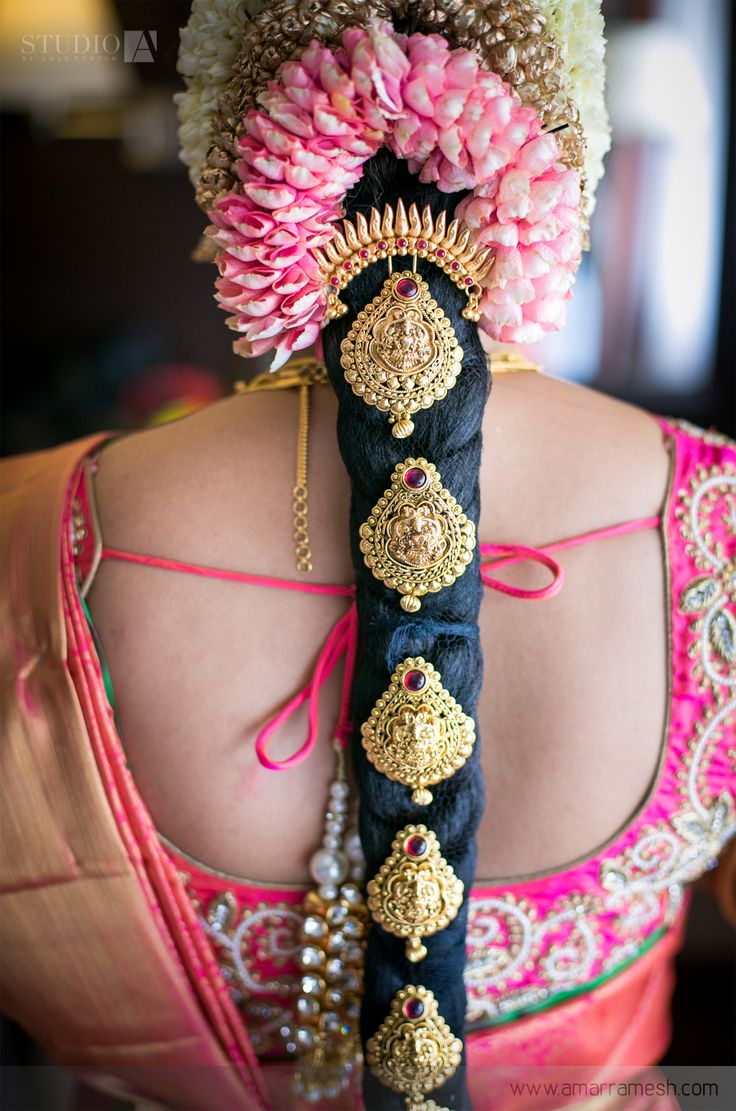 South Indian bride. Gold Indian bridal jewelry.Temple jewelry. Jhumkis.Pink silk kanchipuram sari.Braid with fresh flowers. Tamil bride. Telugu bride. Kannada bride. Hindu bride. Malayalee bride.Kerala bride.South Indian wedding.