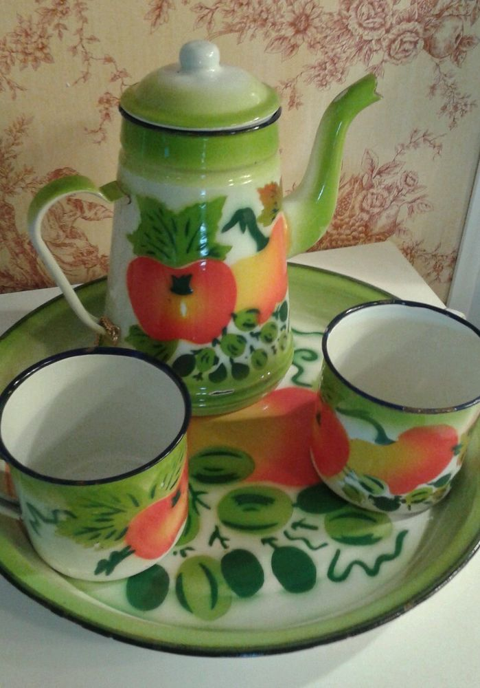 Vintage enamelware fruit pattern, serving tray, teapot and two cups.