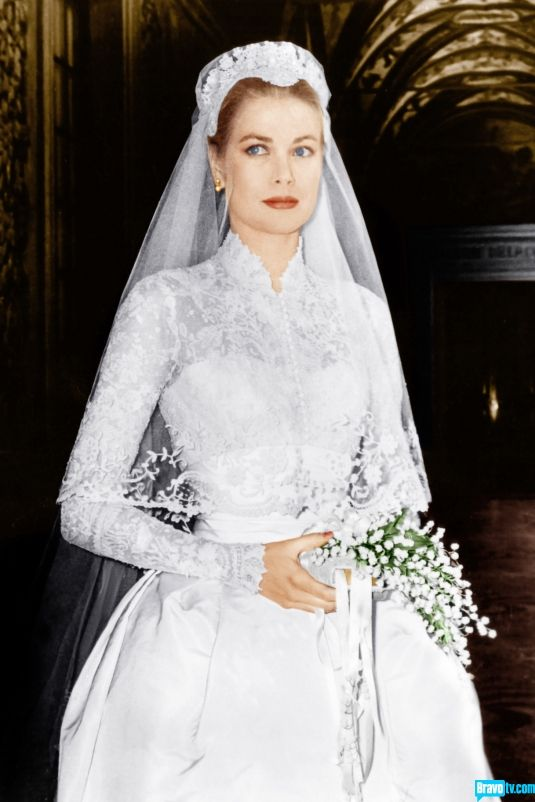 Grace Kelly: is there anyone more elegant? Those delicate sleeves are not only made of antique lace, but are pearl studded. Click for a gallery of iconic wedding gowns.
