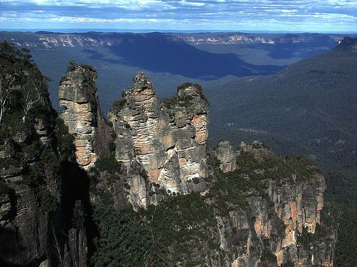 There is a myth that the Three Sisters in the Blue mountains of Australia are three grils turned to stone to save them from an attack from a bunyip. Description from hubpages.com. I searched for this on bing.com/images