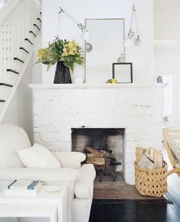 Source Unknown {white rustic eclectic vintage modern living room with white brick fireplace}