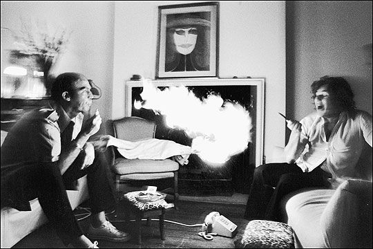 Hunter S. Thompson exhaling lighter fluid at Jann Wenner, 1976, Annie Liebovitz