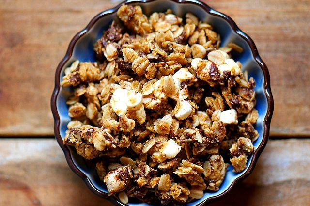 Need some tasty treats on the road? This Vegan S'Mores Granola - with bits of chocolate, nuts, and vegetarian marshmallow - will satisfy your sweet tooth and keep you going for miles and miles!
