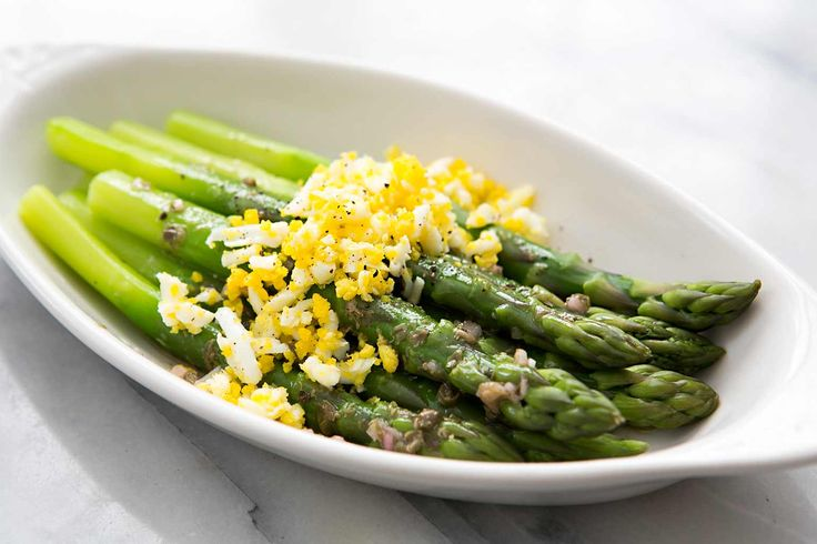 Asparagus Mimosa! Asparagus spears, boiled until crisp tender, served with grated boiled eggs and a caper vinaigrette.