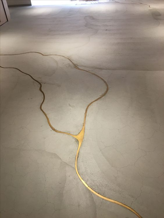 If our concrete floor cracks, we're doing this to it! It's concrete with liquid gold to fill the cracks!