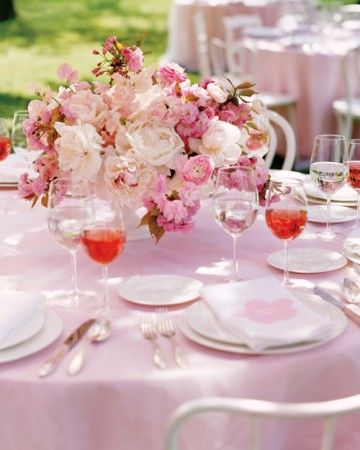 This cherry blossom centerpiece features a combination of flowers large (peonies and ranunculus), medium (sweet peas), and 'Kwanzan' cherry branches, which gives it dimension.