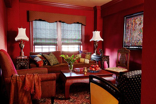 The richness here is really appealing, though just like the other red room, the individual furniture pieces (and those lamps) aren't my style.