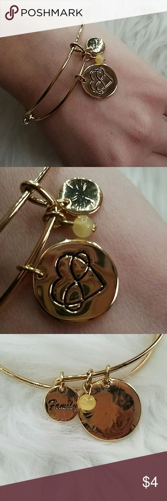 Gold charm bracelet Never worn. Heart infinity sign on one charm. Other charm says family. Bead charm is a pastel yellow. Jewelry Bracelets