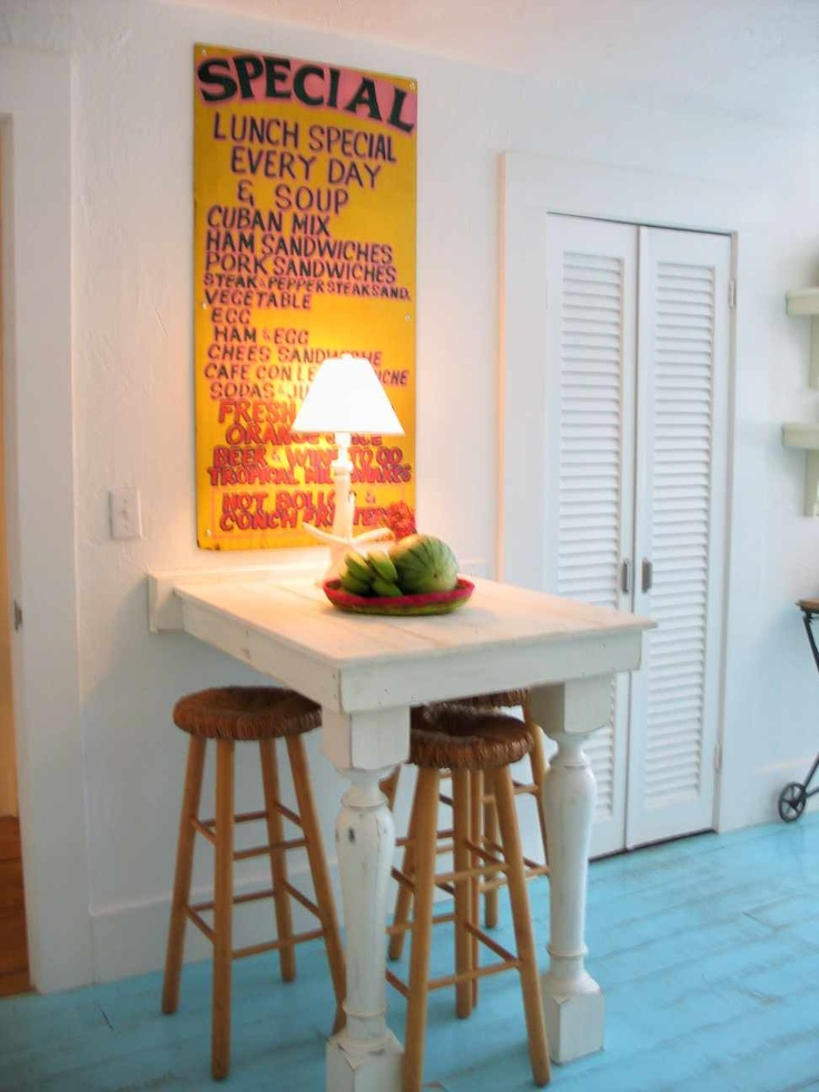 BREAKFAST TABLE WITH CONCH QUEEN COFFEE SIGN. The legs for this table came from the Casa Marina Hotel...I found them on a morning bike ride...in their trash bin. The sign is from an old Key West business, no longer around.