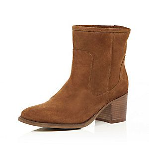 A tan suede ankle boots with high heel