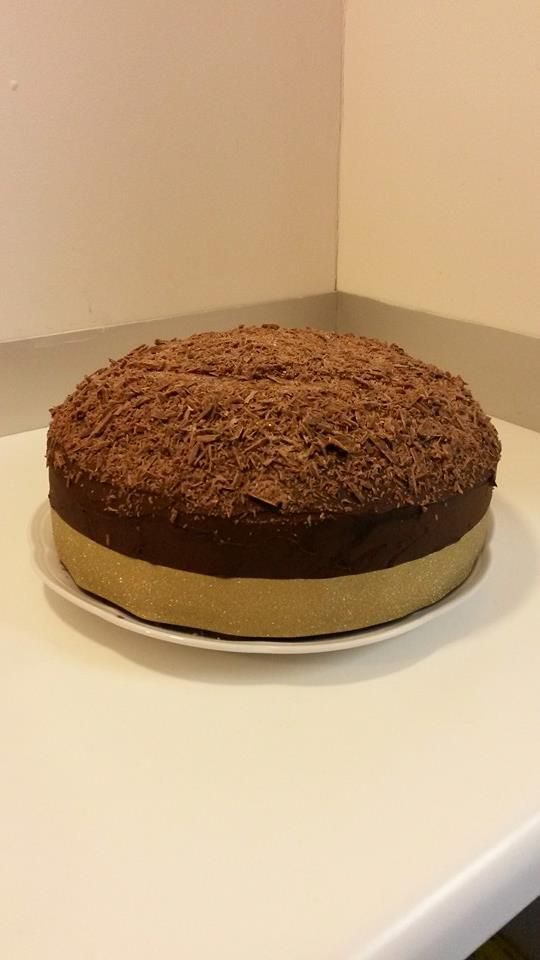 Chocolate cake with chocolate buttercream icing and chocolate shavings