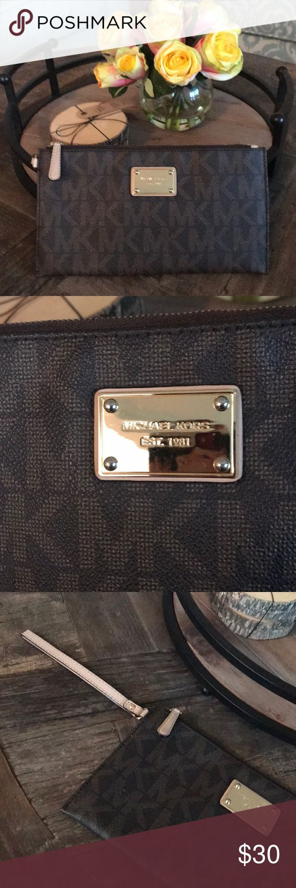 Michael Kors Brown Wristlet Clutch Michael Kors Brown Wristlet. Perfect condition. No wear or tears. Practically new and right from the factory! Michael Kors Bags Clutches & Wristlets