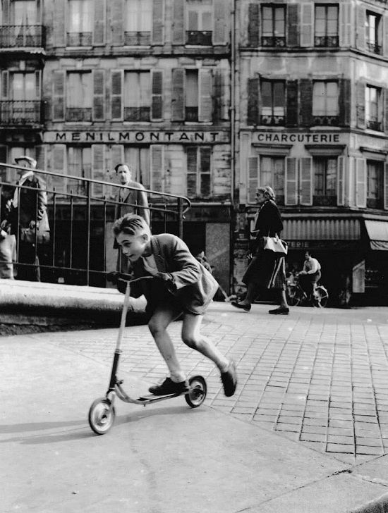 The boy with scooter at Ménilmontant Paris 1934 Robert Doisneau