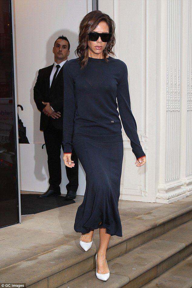 Oh so chic: Victoria made an equally glamorous exit from the store a few hours later