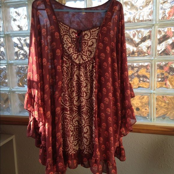 FINAL REDUCTION!! ⭐️⭐️Free People Batwing Dress Beautiful batwing dress, hits just above knee! Absolutely stunning ruffle detail, eye catching pattern and flattering cut! Size XS! Sold Out, the only one on all reselling sites! No trades! Free People Dresses