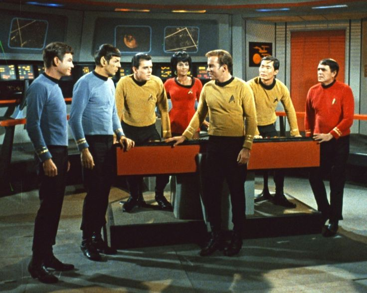 "In this undated photo released by Paramount Pictures, DeForest Kelley, Leonard Nimoy, Walter Koenig, Nichelle Nichols, William Shatner, George Takei, and James Doohan, in the original ""Star Trek"" television series. (AP Photo/Paramount)"
