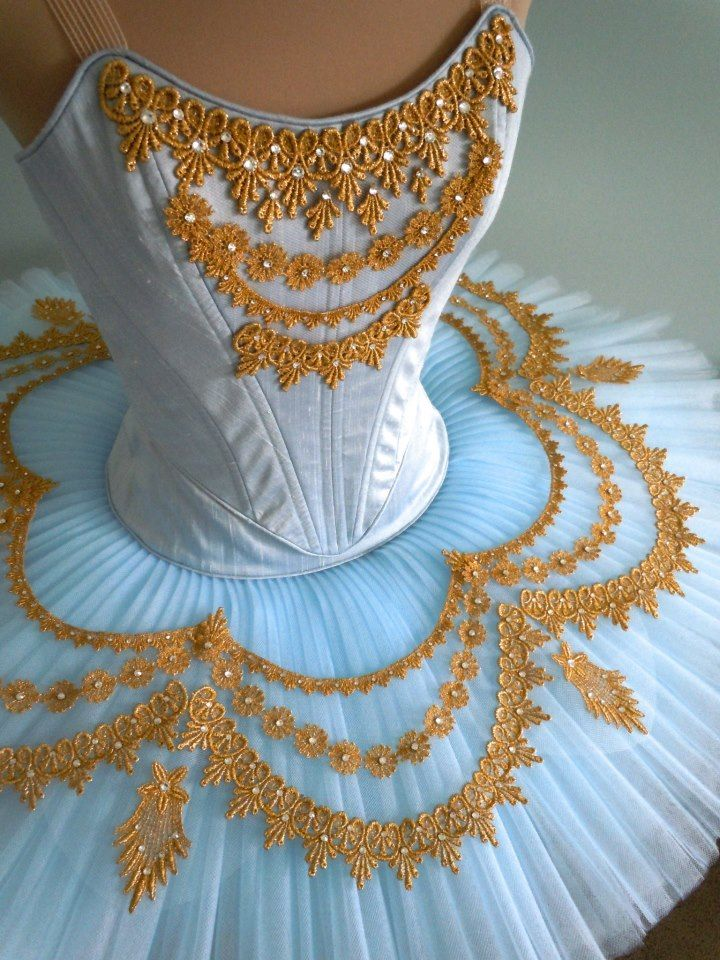 Light blue and gold. To follow more boards dedicated to dance photography, pas de deux, little ballerinas, quotes, pointe shoes, makeup and ballet feet follow me www.pinterest.com/carjhb. I also direct the Mogale Youth Ballet and if you'd like to be patron of our company and keep art alive in Africa, head over to www.facebook.com/mogaleballet like us and send me a message!