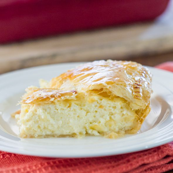 Greek Savory Cheese Pie - a traditional and very popular European treat. A cheese pie filling made with bechamel sauce, feta cheese, ricotta between 2 layers of puff pastry.