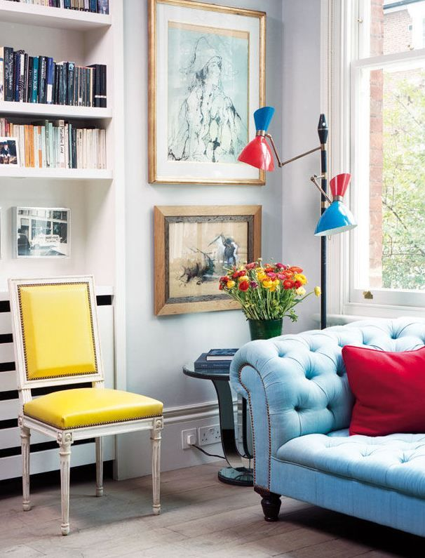 bright living room accents, yellow chair: Primary Colors, Living Rooms, Elle Decor, Blue Couch, Interiors Design, Modern Houses, Yellow Chairs, Sofas, Bright Colors