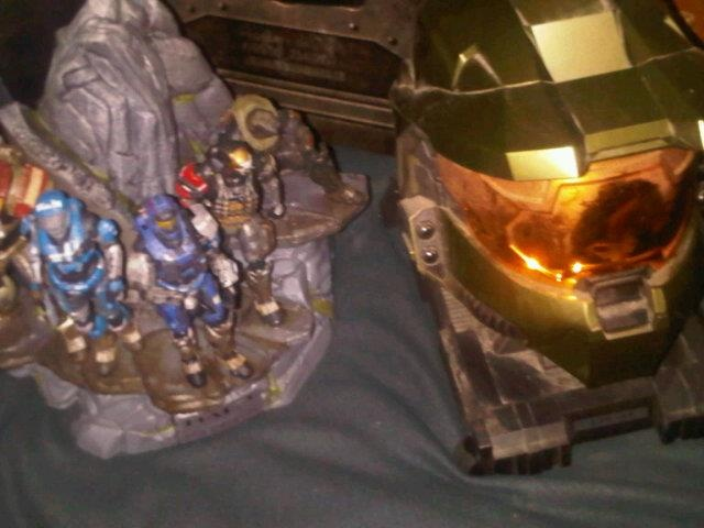 Master Chief's helmet replica from Halo 3 Legendary Edition and Noble Team figures from Halo Reach Legendary Edition