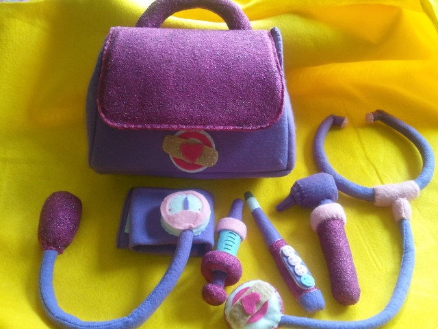 this is a doc mcstuffins doctors bag that comes complete with a stethscope syringe blood pressure cuff otoscope and a thermometer - Doc Mcstuffins Halloween Bag