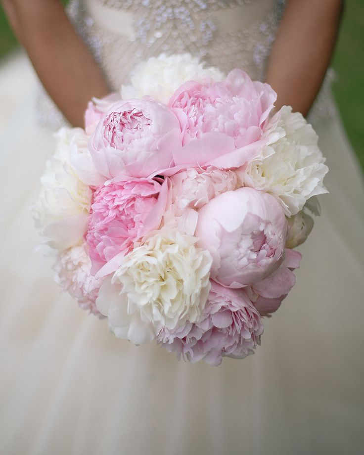 White and pink Peonies make for the most romantic wedding bouquet. See more of this fairy tale wedding from @disneyweddings