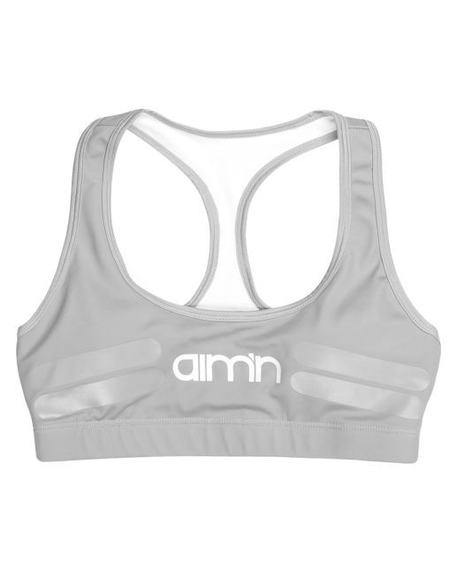 Padded sports bra in grey, with a T-strap style in the back and a waistband for added support. This bra is made from our favourite fabric - the same materia