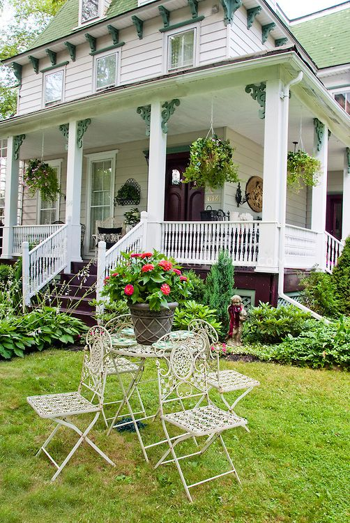 Old Victorian Style House With Rustic Antique Recycled Garden Patio  Furniture, Pots In Containers,